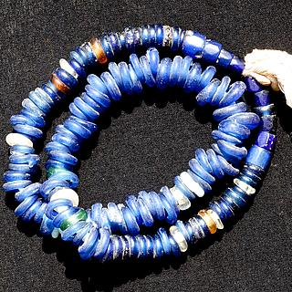 "A strand of mixed colored ""Dogon"" Glass Rings 05.13.1555"